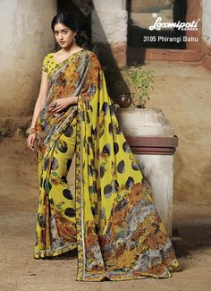 Big polka dots on this yellow floral printed attire is attraction part of the whole saree.