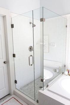 frameless glass shower next to tiled tub. like the border around the edge of the subway tile Upstairs Bathrooms, Master Bathroom, Master Shower, Bathroom Inspo, Small Bathrooms, Bathroom Ideas, Bathroom Renos, Bathroom Renovations, Glass Shower Enclosures