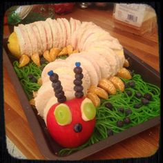 """Kids Birthday Party Idea, Food for Kids: The very hungry (and healthy) caterpillar :-)  Sandwiches, stick together with toothpicks,  Apple for a head, blueberries and oranges. The """"gras"""" are sweets, Apple-flavoured. (""""schüre"""" in german:-))"""