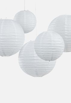 Whether you're adding a personalised touch to a rustic wedding or just trying to make an effort for that dinner party you forgot to plan for, these white paper lanterns are the ideal decorative statement without being overbearing.