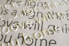 print out what you want to write, cover with wax paper, use puffy paint to trace the letters, let dry, then peel & apply to canvas with modge podge. great idea for us font snobs!