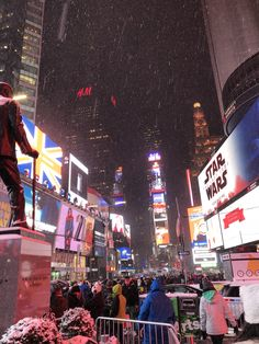 Times Square in the snow- A New York City Christmas – Striped Pineapple
