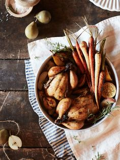 We're making no (wish) bones about it: as ardent advocates for getting cozy in the kitchen we welcome fall's dwindling temps and complementary comfort-food cravings.On the menu tonight? Pristinely prepped Cornish hens, dressed, roasted and basted to perfection atop an abundance of root veggies. For an extra-autumnal touch, we added juicy, just-sweet-enough pears and a …