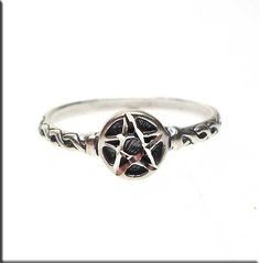 Cast in solid .925 sterling silver, this Pentacle Ring has woven raised design around the Pentacle focal-point. Pentacle center has been