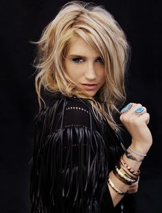Ke$ha; she might look trashy and might be crazy but she's my guilty pleasure <3