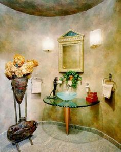 Powder bathroom with a simple inexpensive wallpaper... Chipped glass pedastal with spun copper base lends a clean atmosphere to the space.