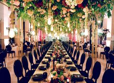 YONDER DESIGN // The grand table at this Bently Reserve wedding sat under a canopy of thousands of live and silk flowers. Each place had a custom menu, printed in gold foil on black museum board and tied with an acrylic placecard etched with each guest's name.  TAGS // menu, wedding menus, tablescape, acrylic, wedding details, graphic design, moody, floral, modern wedding, black tie, yonder design, weddings, shannon leahy events, jose villa