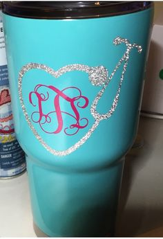 Nurse heart stethoscope with monogram on an RTIC or Yeti tumbler. Vinyl monogram made with Cricut. Used app called Monogram It. RN, personalized coffee travel mug.