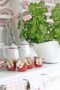 Warm my heart- vintage enamelware and mason jars of goodness, fresh linens, and a geranium. <3