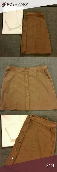 """14TH & UNION light brown faux suede mini skirt This is a sad re-posh. I love, love, love this skirt but it will not contain my 44"""" hips. The skirt is washed, clean and free of stains, tears and defects. It was gently worn from previous owner. It's a poly/spandex blend and fully lined with a very soft material. The skirt buttons up in the front and features two functional front pockets. It measures 16"""" across the waist (laid flat) and 21"""" at the hips (laid flat). It is about 16.5"""" long from…"""