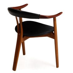 Three-legged armchair with oak frame and teak armrests Y-shaped hindleg, seat and back with black patinated leather. Model 308. Manufactured and stamped by Mogens Kold Møbelfabrik, 1950's.