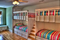 Long Bunk Bed with Stairs and Colorful Bedding in Tropical Kids Bedroom Design Ideas