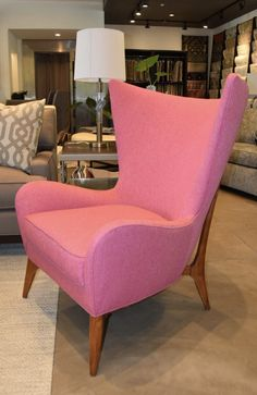 One of our favorite chairs in the showroom #AbodeMarin #MidCenturyModern #Pinkchair #PopOfPink
