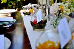 pre-plant your flower favor by assembling tiny terrariums that double as place card holders  @myweddingdotcom