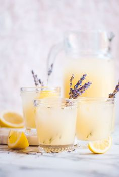 Grab yourself a glass of this refreshing lavender lemonade cocktail! This lavender lemonade cocktail recipe is a fun twist on the classic lemonade. All you need to do is whip up some lemon peel lemonade, make an easy lavender simple syrup, and Lemonade Cocktail, Cocktail Drinks, Fun Drinks, Alcoholic Drinks, Lavender Cocktail, Beverages, Lemonade Drink, Cocktail Glass, Cupcake Stands