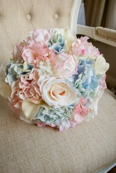 Summer wedding bouquet in blue, blush pink and ivory. Made with artificial roses, peonies, calla lilies, lisianthus, gypsophilia and hydrangea.