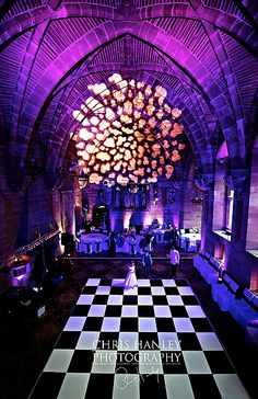 Peckforton Castle with purple lighting and break up gobo and Black and White Dancefloor from Hipswing Events