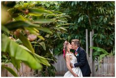 Bride & Groom in the lush grounds of the Perth Zoo.  Photography by Trish Woodford Photography