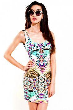 http://www.slimskii.com/floral-sublimation-print-cross-back-dress/