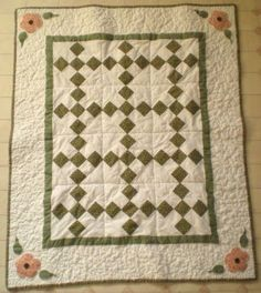 Quilt with  pink flowers