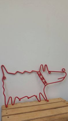 Check out this item in my Etsy shop https://www.etsy.com/listing/273259920/vintage-modern-metal-red-dog-wall