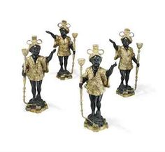 A SET OF FOUR LACQUERED BRONZE AND PAINTED BLACKAMOOR CANDLESTICKS