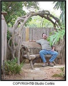 Faux Bois | The Art of Sculpting Concrete Faux or Fake Wood Objects - this is artist Carlos Cortes with two of his creations. Martha Stewart recently commissioned Mr. Cortes to fabricate a table for her.