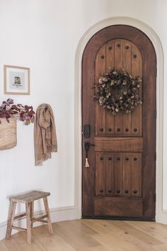 First impressions are everything! Welcome your holiday house guests with a stunning real touch burgundy eucaylyptus wreath. Perfect for indoors or out, this wreath feels as real as it looks. Shop the look by @jennasuedesign at Afloral.com.