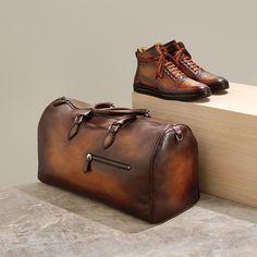 LEADER OF THE PACK. Berluti playtime high-top sneakers $2350. Jour-Off weekend bag $5235. Both in tobacco bis Venezia leather.