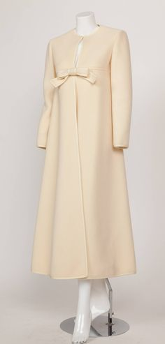 1960s Pierre Cardin A-Line Creme Melton Wool Coat w/Bow and Silky Trim | From a collection of rare vintage coats and outerwear $2,100