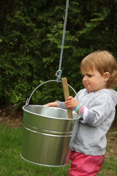 Bucket and Rope Contraption - One of the most popular play stations in our yard.  This easy set-up provides hours of open-ended fun and learning! - Happy Hooligans