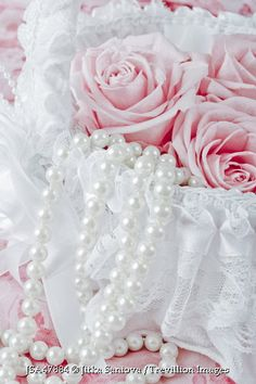 Trevillion Images - roses-and-pearls-in-lace-covered-box