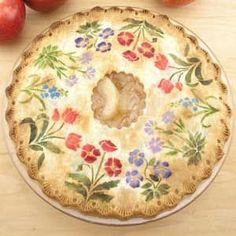 Anyone can do this one - all it takes is an extra minute to apply cinnamon sugar or powdered food colors on your rolled out pie crust top then bake as usual.