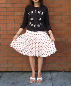 zoe karssen creme de la creme sweatshirt and prada lips print pleated skirt with white birkenstocks