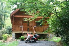 This 1400 sq. ft. cabin has an 8' roof overhanging the deck...great covered place to sit and stare at the motorcycles following a ride in the Blue Ridge Mountains!