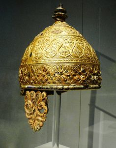 This ancient piece of art, known as the Parade Helmet, dates back to c.350 BCE and was found buried in a cave in Agris, Western France. The cap, neck guard and cheek guards are all cluttered with lavish gold tendril and leaf design with the gold, red coral inlays providing an effectual contrast.