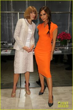 Victoria Beckham is wearing ORANGE and still looks amazing. The look is perfection with the cut of the dress, that tousled hair, and those suede pumps.