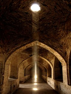 A caravanserai in Iran. The light from the arched ceiling repeats in an inviting way.