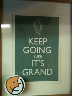 """Swipped """"Keep Going Sure It's Grand"""" sign."""