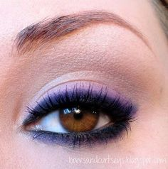 Rim eyes with black liner, then smoke the line with purple shadow