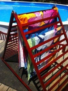 Folding poolside towel rack