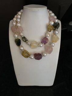 Amethyst, lemon quartz, rose quartz, prehnite and fresh water pearls. Contact: franschhoekjade@telkomsa.net