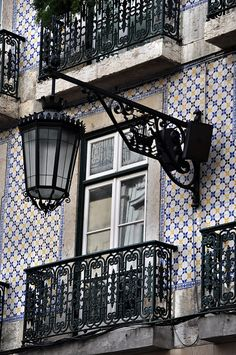 Typical azulejo/tile covered building - Lisbon, Portugal I love tiles. Lisbon is on my must see list. Spain And Portugal, Portugal Travel, Visit Portugal, Algarve, The Places Youll Go, Places To Go, Portuguese Tiles, Street Lamp, Windows And Doors