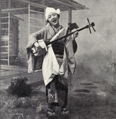 Playing the shamisen, 1899. S)
