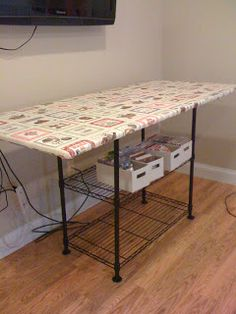Make a removable ironing board top that can be placed against the wall when not in use for more space. Open shelving below makes it a perfect place to store the sewing machine and fabric.