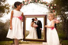 "Sweet wedding photo idea: the flower girls ""frame"" the bride and groom."