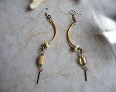 Mismatched Indian Glass Bead, Gold plated Brass Tube & Bone Dangle Drop Earrings by cherokeedancing. Explore more products on http://cherokeedancing.etsy.com