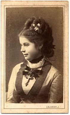 Interesting hairstyle from the 1870s. Beautiful portrait of this Victorian young lady.