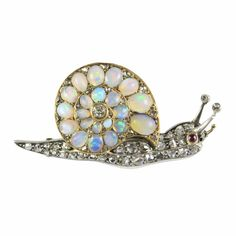 A Victorian opal and diamond snail brooch