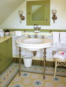 The restored bathroom in an 1894 house boasts a complex mosaic floor that resembles a richly detailed rug. Quilters dream floor.